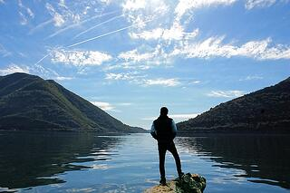 Man thinking while looking out at the lake
